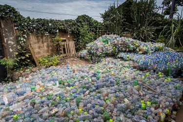 Plastic waste in the courtyard, in front of the offices and the studio, of the artistic collective Afrika Arts Kollective which brings together artists and creators who work mainly from waste.