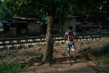 Alan (17), an unaccompanied Guatemalan migrant, looks for water to brush his teeth beside the train tracks where 'La Bestia', or the Beast, passes through, the train that many migrants have illegally...