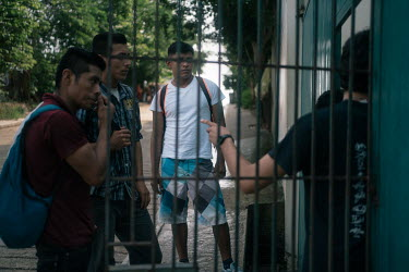 Alan (17), an unaccompanied Guatemalan migrant, waits for his turn to enter the Casa del Caminante Jtatic Samuel Ruiz Garcia shelter. That morning, he escaped from a bus where Mexican immigration agen...