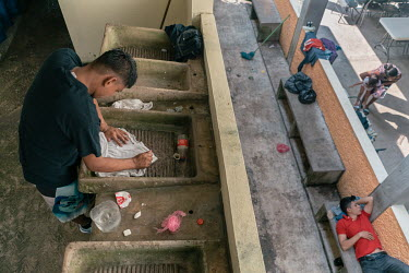 Alan (17), an unaccompanied Guatemalan migrant, washes the shirt that he used for the last couple of days, at the Casa del Caminante Jtatic Samuel Ruiz Garcia shelter. That morning, he escaped from a...