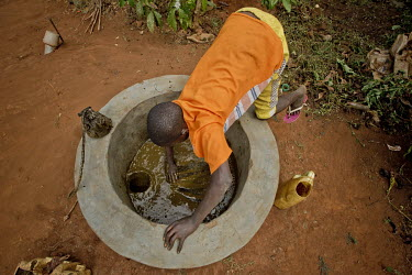 In Kayounga district, 60 kilometres from Kampala, a young boy mixes cow dung with water in a cement bowl which is connected to an underground fermentation tank in the yard of the family house. The fer...