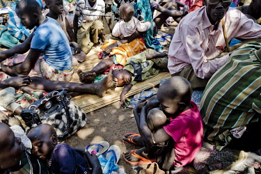 South Sudanese refugees waiting for transport to take them from the overcrowded Dzaipi transit centre to a newly established Dzaipi II camp.