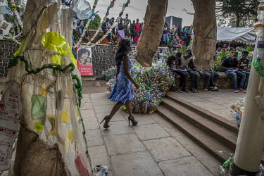 At the Kampala National Theatre, a model parades during a fashion show of creations made by the Afrika Arts Kollective collective, whose niche is waste recovery, with the aim of raising public awarene...