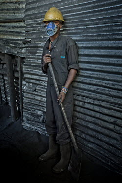 A worker at Green Bio Energy where they produce fuel briquettes based on agricultural residues and leftover coal, its combustion up to twice as slow as traditional fuels, allowing savings of 40 to 50%...