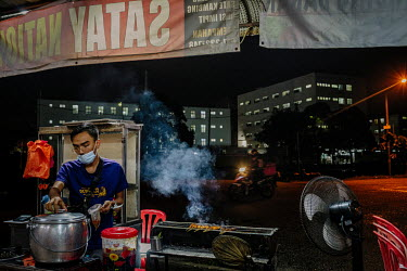 A food stall behind Kosan Rubber Industries Bhd. Locals and migrant workers occasionally visit shops and eateries on this street behind Kossan Rubber Industries Bhd. The company has temporarily suspen...