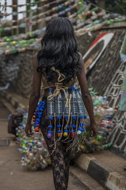 A model at the Trash on Fashion Show, part of the Bayimba cultural festival at the Kampala National Theatre, wearing clothes and jewellery made from waste plastic created by the Afrika Arts Kollective...