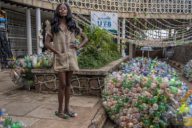 A model at the Trash on Fashion Show, part of the Bayimba cultural festival at the Kampala National Theatre, wearing clothes made from a hessian sack created by the Afrika Arts Kollective, which speci...
