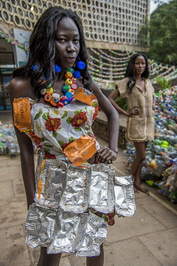 A model at the Trash on Fashion Show, part of the Bayimba cultural festival at the Kampala National Theatre, wearing clothes and jewellery made from waste plastic and foil food trays created by Gisa J...