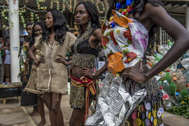 Models at the Trash on Fashion Show, part of the Bayimba cultural festival at the Kampala National Theatre, wearing clothes made from old hessian sacks, plastic and metal waste, all created by the Afr...
