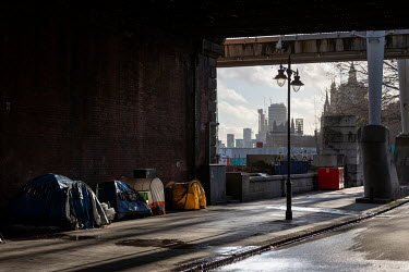Homeless people's tents erected on the pavement beneath Hungerford Bridge.