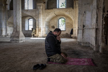 An Azerbaijani soldier wipes a way tears as he prayers in a mosque in Agdam city, which had been handed back to Azerbaijan after nearly 30 years of Armenian control. The mosque was reported to be the...