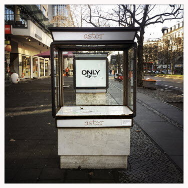 An empty display case in front of a closed shop on the Kurfuerstendamm.