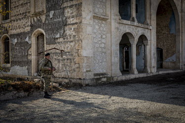 An Azerbaijani soldier on guard outside the central mosque in the city of Agdam which, after nearly 30 years under the control of Armenian forces, is now a ruin. Originally home to nearly 40,000 peopl...