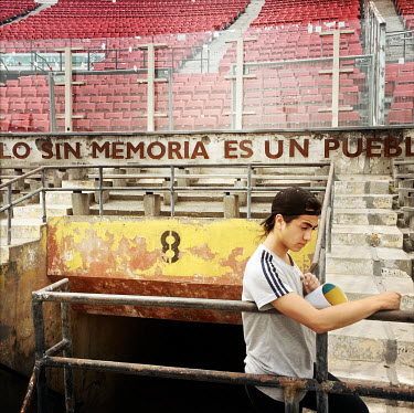 A visitor at the national stadium (Estadio Nacional), which is now a memorial to political prisoners and disappeared victims of the Pinochet dictatorship.
