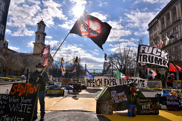 Anti-Trump protesters as close as one can get to the White House on the day before Joe Biden's inauguration with the city under a lockdown to prevent any possible violent demonstrations aimed at disru...