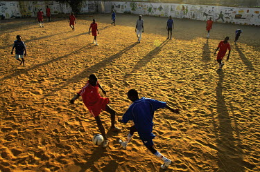 Children playing in a football match at the end of the day in a Transit and Orientation Centre for former child soldiers.