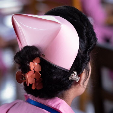The pink hat is part of the uniform for the midwifery students at the university hospital in the capital Dhaka. Most young women who have chosen the profession want to help reduce maternal and child m...