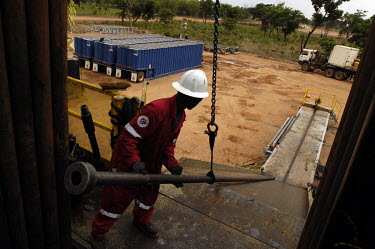 A worker of Weatherford International, an Esso contractor, dismantles the drill from RIG 292 in the Kome 5 oil well.