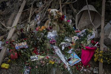 Flowers, teddybears and family photos placed at a makeshift shrine at the site of a scud missile attack in the Cevathan neighbourhood�of Ganja, Azerbaijan's second largest city. The residential area...
