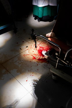 Blood covers the floor during a birth in the labour room at Sadar hospital in Cox�s Bazar.