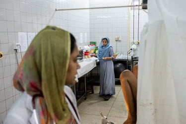 Masuda Khanom, one of nearly 6,500 midwives in Bangladesh, working in the delivery room at one of Dhaka's largest hospitals.