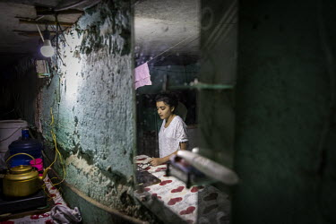 Abasova Yasamin (12) cooks lunch for her family in the basement of an unfinished school in Baku where several hundred families who fled previous conflicts in Nagorno-Karabakh have lived for more than...
