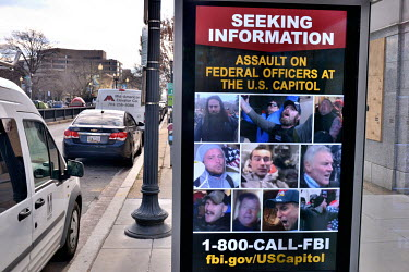 An FBI poster at a DC bus stop seeking information on some of the 6 January 2021 Capitol insurrectionists.  On the day before Joe Biden's inauguration, the city is under a lockdown to prevent any poss...