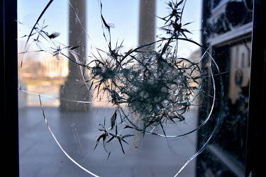 A window at the Capitol left broken and blood-smeared after the invasion by a pro-Trump mob on 6 January 2021. The Supreme Court building can be seen in the background. In preparation for Joe Biden's...