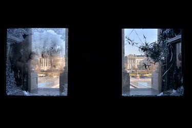 Shattered windows at the Capitol, damaged during the invasion by a pro-Trump mob on 6 January 2021. The Supreme Court is the building in the background on the left. In preparation for Joe Biden's inau...