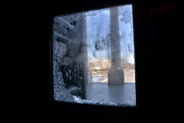 A shattered window at the Capitol, damaged during the invasion by a pro-Trump mob on 6 January 2021. The Supreme Court building can be seen in the background. In preparation for Joe Biden's inaugurati...