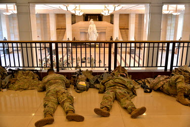 Military personnel rest inside the Capitol. Following the invasion by pro-Trump supporters on 6 January 2021, and in preparation for Joe Biden's inauguration on 20 January 2021, both National Guard an...