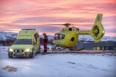 An ambulance meets an Airbus H-145 helicopter after it landed with a patient on a helipad at Kirkenes hospital. The helicopter is operated by Norwegian Air Ambulance, and provides an important medical...