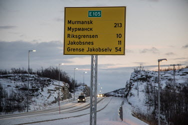 A road sign on the outskirts of Kirkenes, a small town 10 km from the border with Russia, indicating the distances to nearby towns and Murmansk.