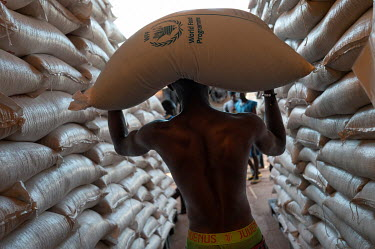 A labourer carries a sack of food onto a truck at the WFP (World Food Program) headquarters in Bambari for transportation of 12.5 tonnes of food to towns and villages further out in the region.