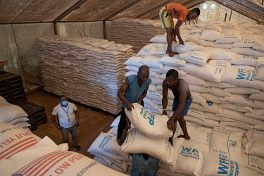 Labourers loading sacks of food onto a truck at the WFP (World Food Program) headquarters in Bambari for transportation of 12.5 tonnes of food to towns and villages further out in the region.