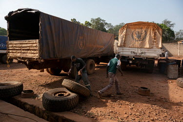 Mechanics prepare a truck at the WFP (World Food Program) headquarters in Bambari for use in the transportation of food aid.