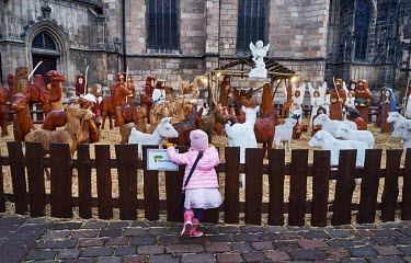 A girl looking at a Nativity scene on the Republic Square (Namesti republiky).