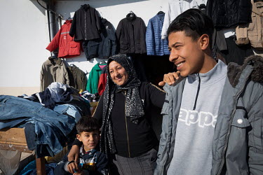 Saida, with two of her sons in front of her shop in an agricultural village outside Sfax. She says she would not like to see her sons leave for Europe, but also understands that there are few prospect...