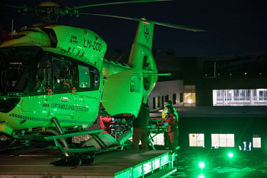 An Airbus H-145 helicopter carrying a patient lands on a helipad at Kirkenes hospital where an ambulance crew meets it. The helicopter is operated by Norwegian Air Ambulance, and provides an important...