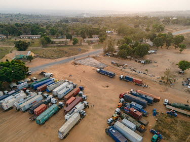 Trucks waiting at the border with Cameroon where COVID-19 testing has resulted in long delays.