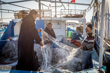 Fishermen in the port of Zarzis talk about the increasing numbers of migrants they encounter at sea as they prepare their nets before setting out to sea. Previously they were often involved in rescue...