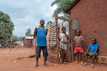 Gerry and his children in District 7. Gerry lost his job as a site guard and since has been struggling to feed his family. He has rented a canoe and goes fishing with no guarantee of being able to eat...