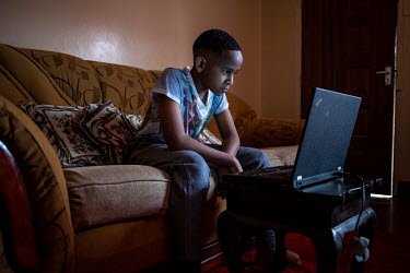 Adrian Murage (12) follows school lessons via Zoom on his laptop at home while the schools are closed due to the coronavirus pandemic.
