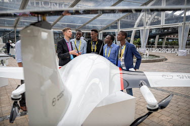 A German representative talks to visitors to the African Drone Forum at the Kigali Convention Centre.