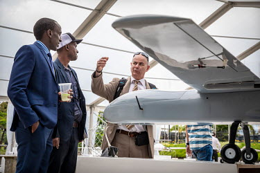 A representative talks to visitors to the African Drone Forum at the Kigali Convention Centre.