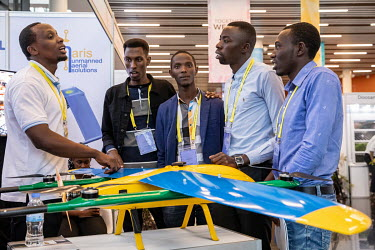 Students talk to the representative of a Rwandan drone manufacturer at the African Drone Forum at the Kigali Convention Centre.