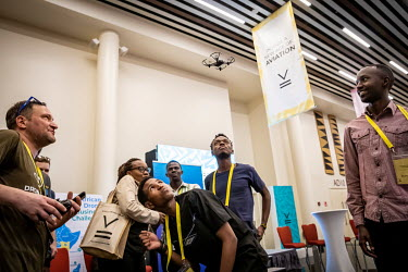Students are given a demonstration of a mini drone at the African Drone Forum at the Kigali Convention Centre.