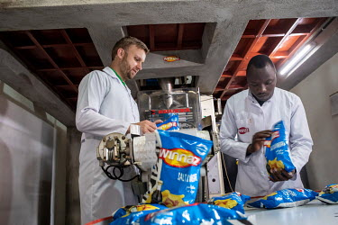 Dutch entrepreneur, Thijs Boer, Founder of Hollanda Fairfoods, together with his production manager, Egide Niyibizi, in his potato crisp factory. The crisps (chips) that are made there are branded Win...