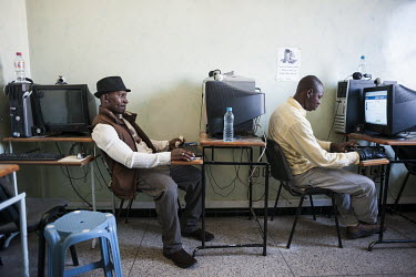Nigerian migrants Sisi Collins Bacongu (right) and Winzo Asulu check their Facebook accounts in an internet cafe. The pair are recently arrived in Tangier where they are trying to earn some money in o...