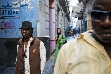 Nigerian migrants Winzo Asulu (34) and Sisi Collins Bacongu walk through the narrow alleys of the city's medina. The pair are recently arrived in Tangier where they are trying to earn some money in or...